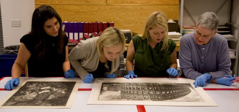 Students looking at print