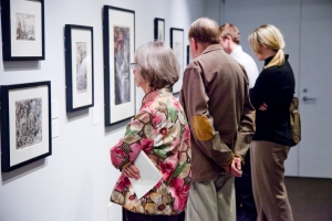 visitors viewing art in a gallery