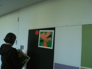Education staff using magnetized versions of artwork on the interactive station