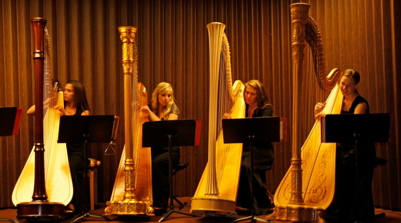 four harpists playing