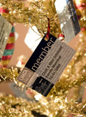 membership card hanging on a christmas tree
