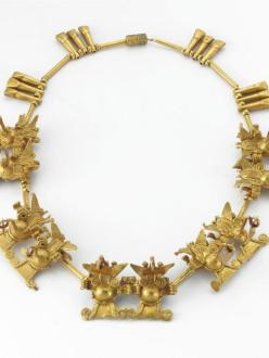 gold necklace with small bat shaped pendants