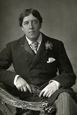 Oscar Wilde wearing his trademark Green Carnation; image care of Wiki Commons