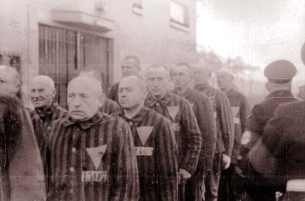 Gay prisoners in Sachsenhausen concentration camp, 1938. The pink triangle these men were forced to wear by the Nazis later became a symbol of the Gay Rights Movement. (US National Archives)
