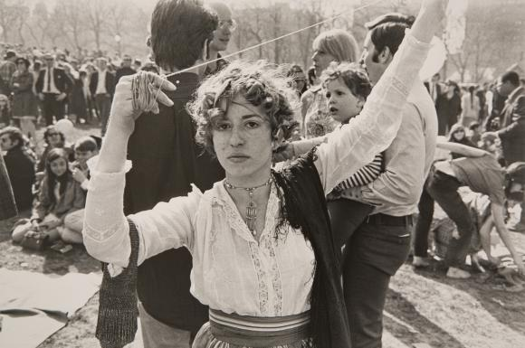 """Woman with String."" Garry Winogrand (1928-1984) American."