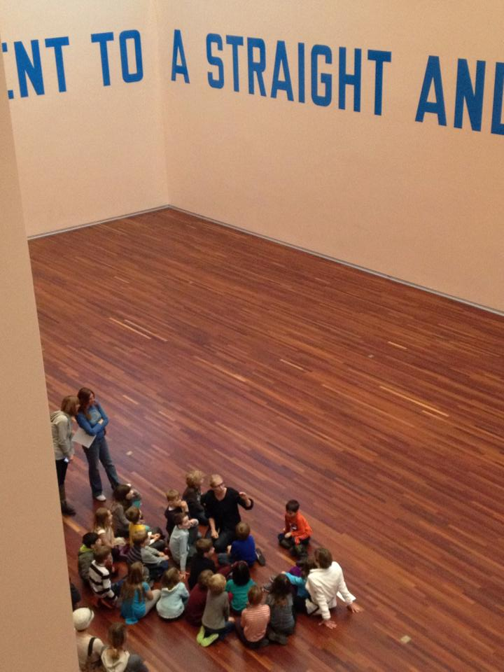 Gretchen in the Great Hall talking to second graders about Lawrence Weiner and Conceptual Art. (photo courtesy of curator Whitney Tassie)