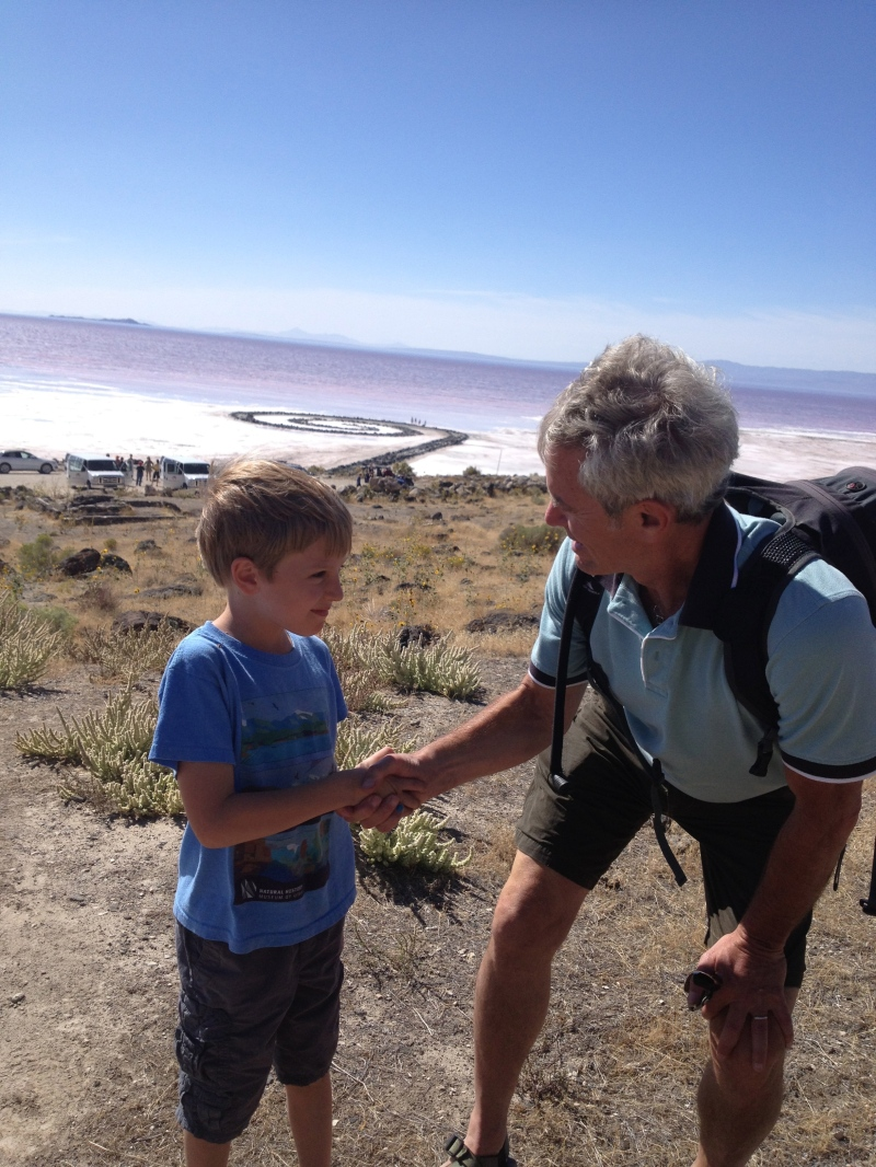 "Gretchen's son, Julian, with Mayor Ralph Becker, on a visit to Spiral Jetty. Says Gretchen, ""It was so fun to take Mayor Becker out to see the Jetty - and JJ was very excited to meet him!"