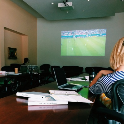 UMFA staff working while watching the 2014 World Cup in the board room.