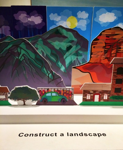 Vistors can take pieces from the holder and place them in different slots to construct a landscape, while learning about foreground, middle-ground and background.